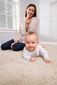 mum and child sitting on carpet