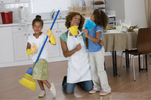woman and two children cleaning